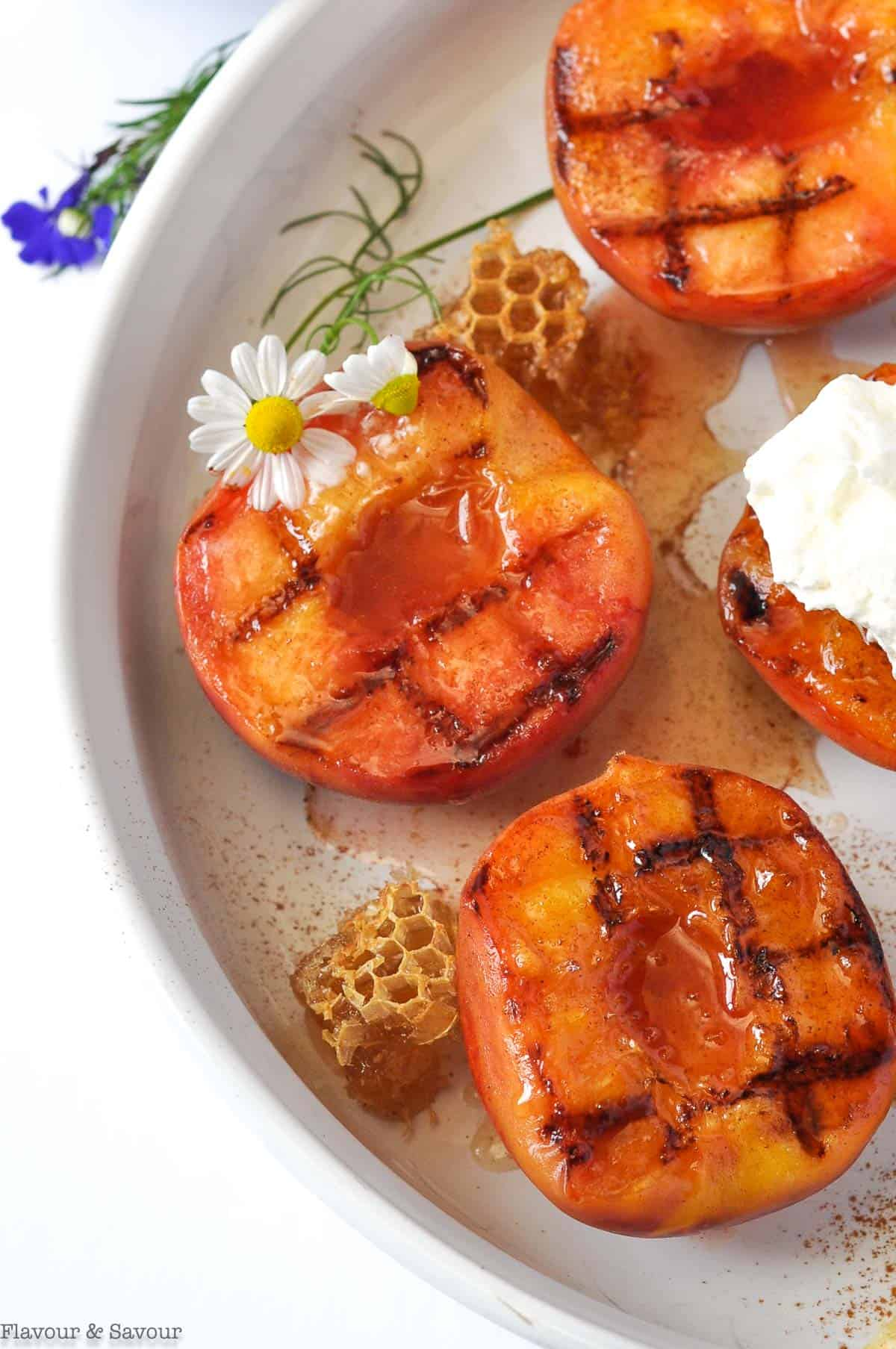 Grilled peaches topped with honey lemon drizzle