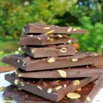 Salted Dark Chocolate Bark with Pumpkin Seeds stacked on a plate