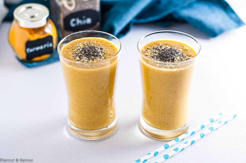 Mango tropical turmeric smoothie glasses with chia and hemp seeds