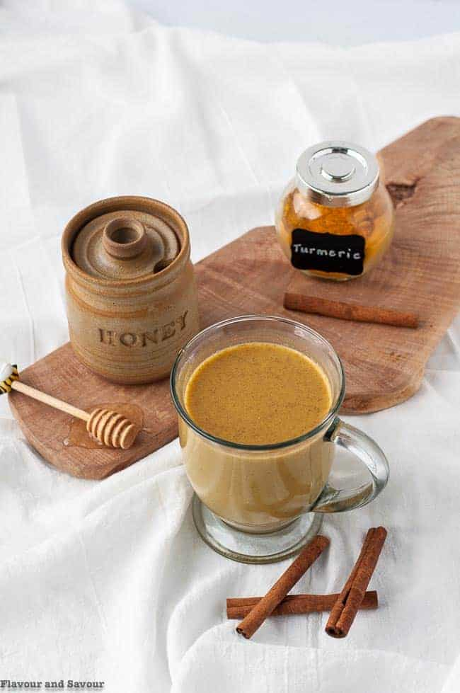 Warm Turmeric Cinnamon Milk with honey
