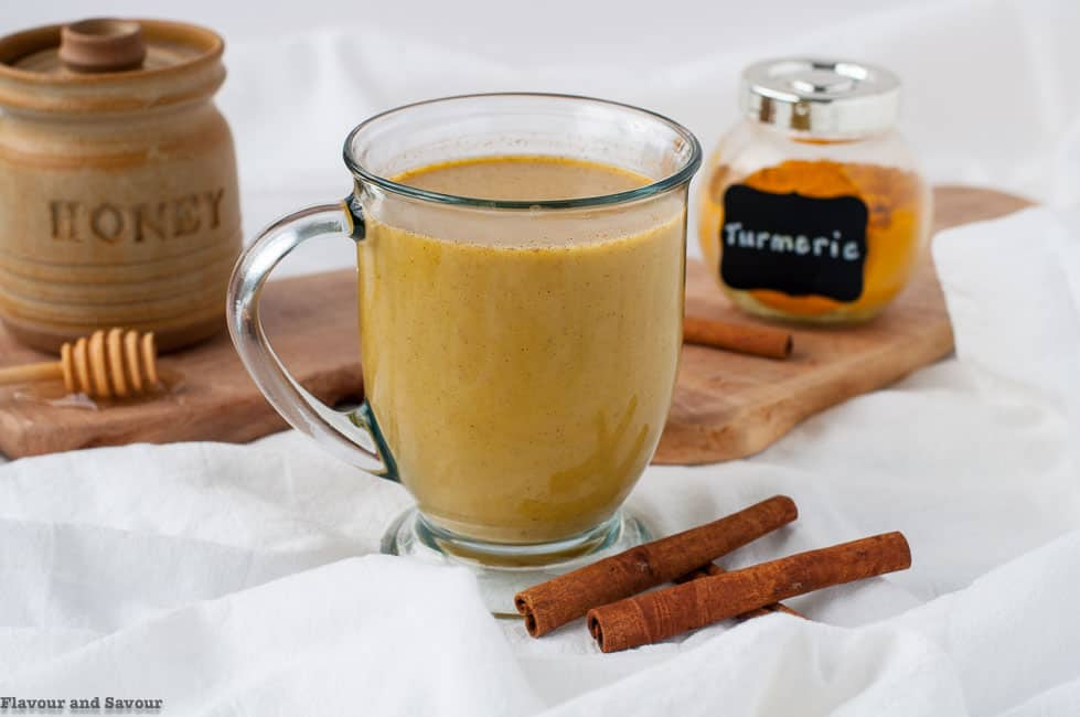 A glass mug of Warm Turmeric Cinnamon Milk or Golden Milk.