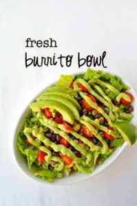 Fresh Burrito Bowl garnished with avocado cream