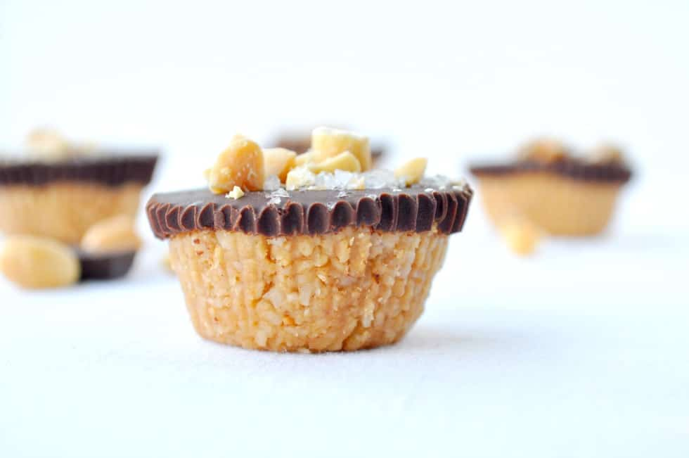 one chocolate peanut butter cups garnished with peanuts and flaky salt