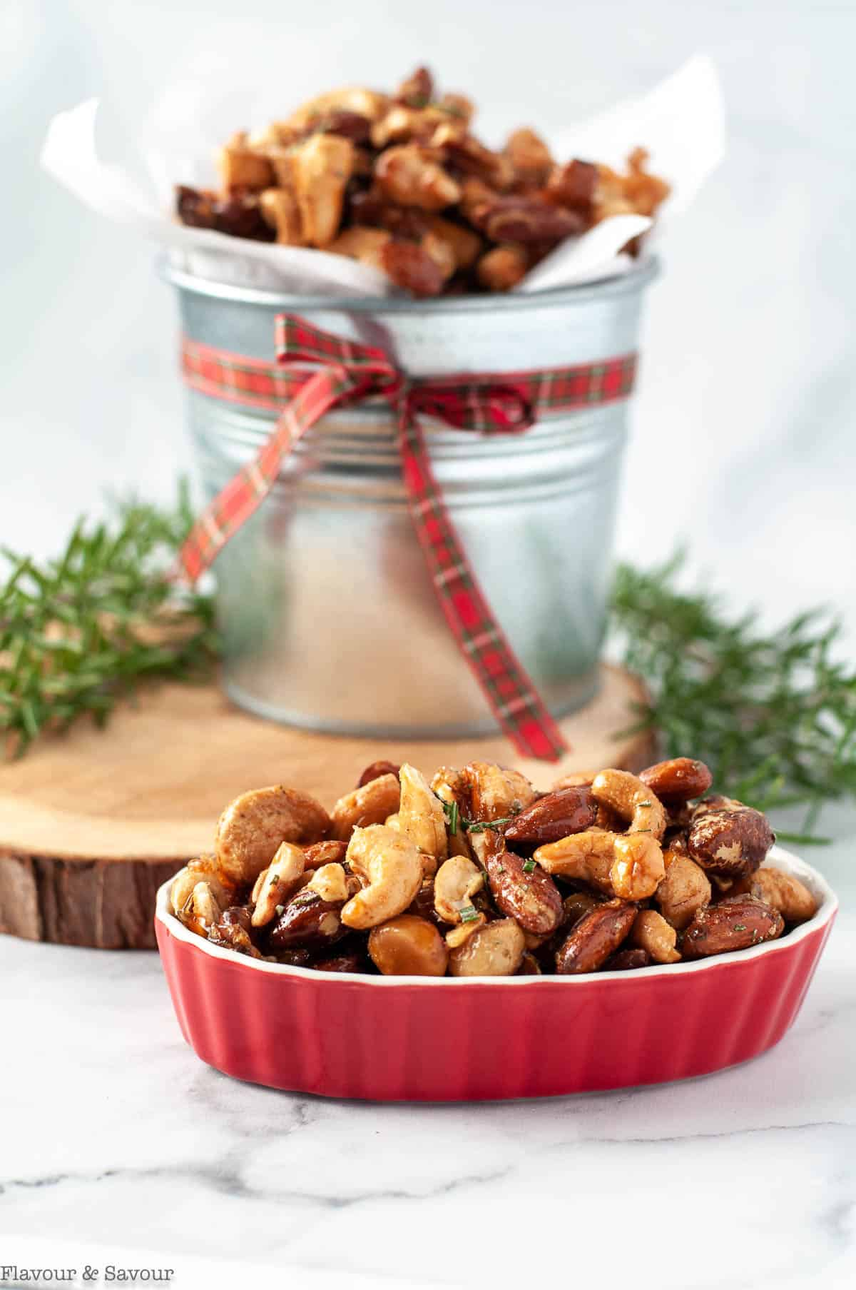 Sweet and Spicy Rosemary Nuts in a tin and a red bowl