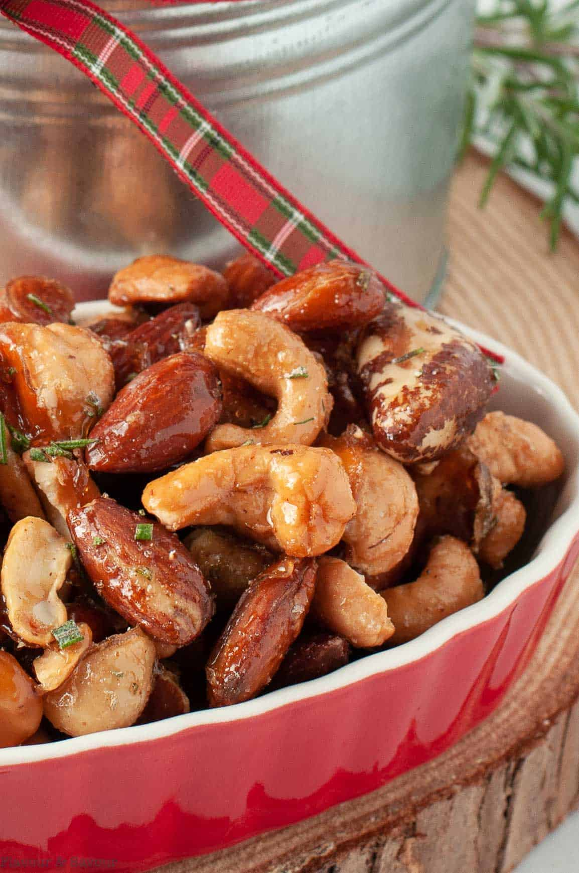 Close up view of rosemary nut mix in a small red dish