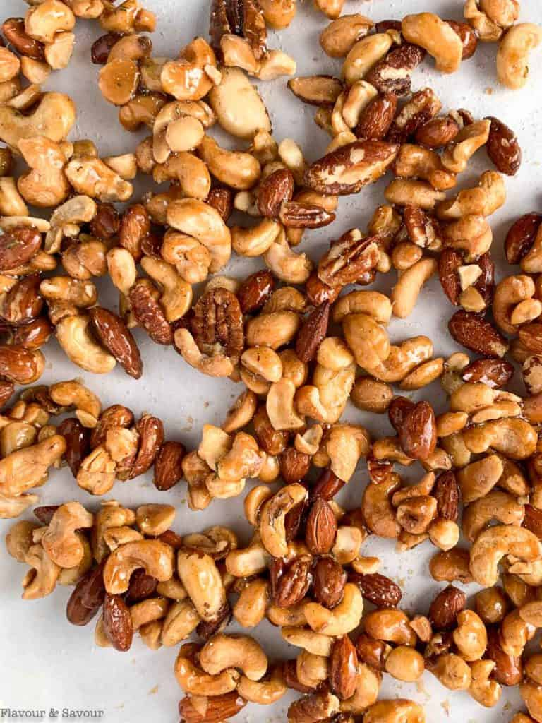Sweet and Spicy Rosemary Nuts on a baking sheet