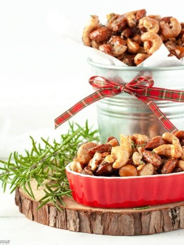 Sweet and Spicy Rosemary Nuts in a tin and in a red serving dish