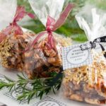 Sweet and Spicy Rosemary Nuts wrapped in gift bags.