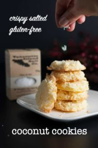 Crispy Salted Coconut Cookies stacked on a plate.
