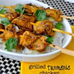 Grilled Turmeric Chicken kabobs on a bed of rice