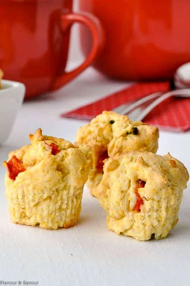 Tiny cornbread muffins with red soup bowls