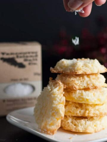 stack of coconut cookies with flaky sea salt