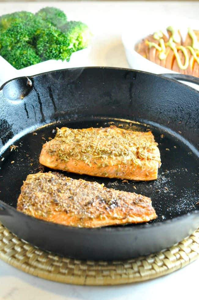 Fennel Crusted Salmon in a cast iron pan