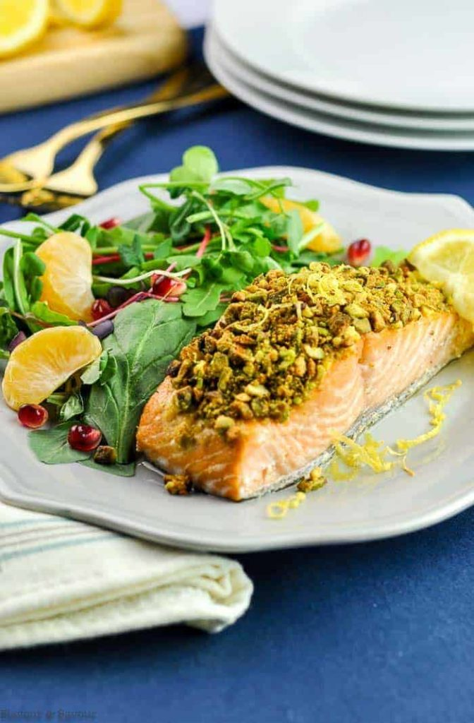 Baked Pistachio-Crusted Salmon with salad on gray plate