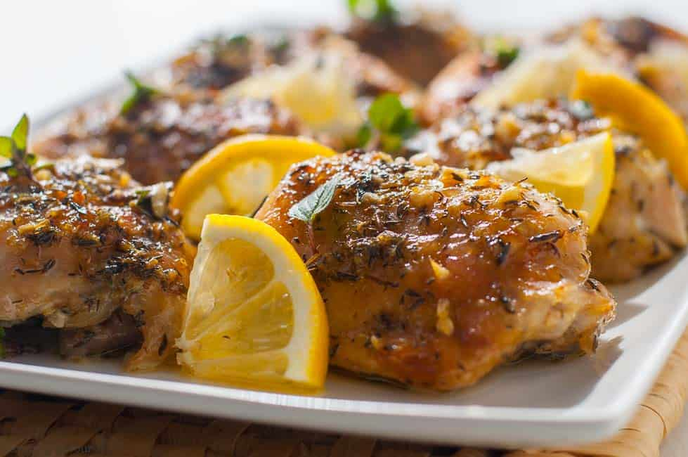 Easy Baked Lemon Chicken on a serving platter with lemon slices