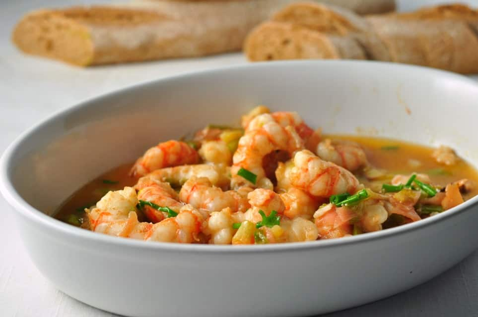 5 - minute Gin-Gingered Prawns in a bowl with a baguette