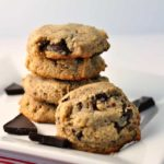 Grain-Free Chocolate Chip Cookies stacked with chocolate chunks on a plate. Flavour and Savour