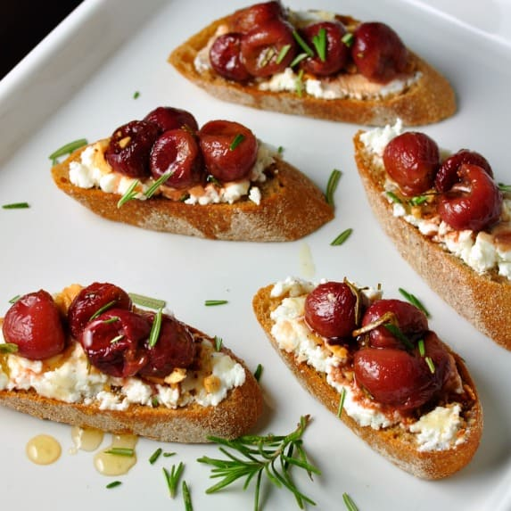 Roasted Grape and Goat Cheese Crostini  www/flavourandsavour.com