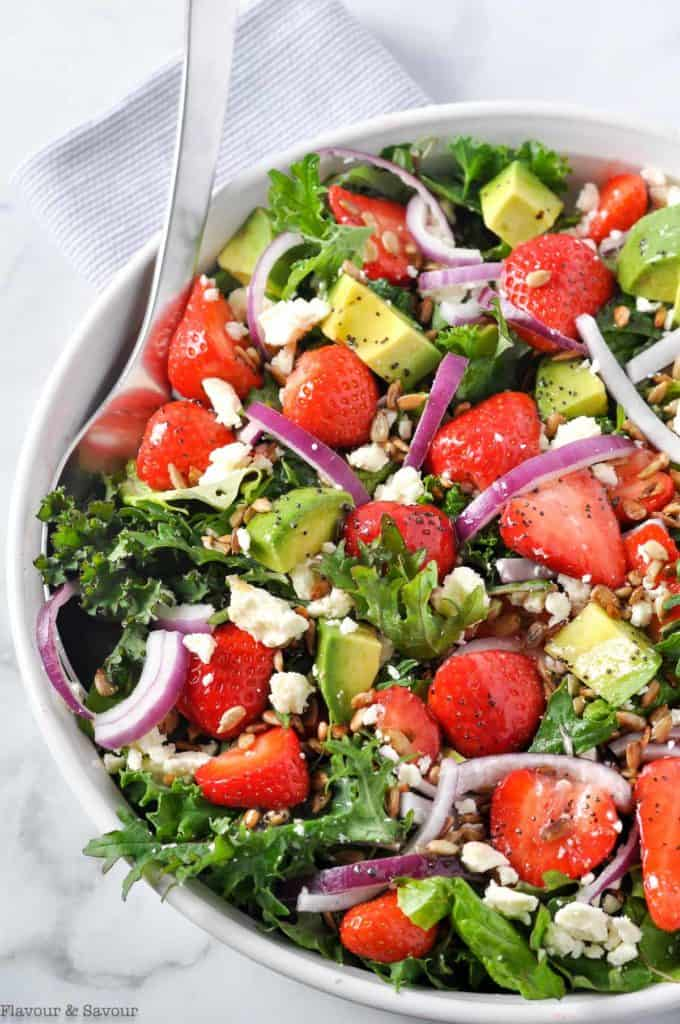 Strawberry Kale Salad with feta, avocado, red onion and toasted sunflower seeds