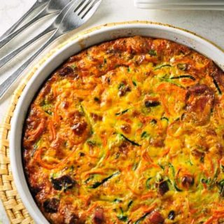 Paleo Zucchini Carrot Quiche in a white round baking dish.
