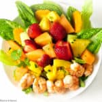 Southwestern Prawn Fruit Salad overhead view with grilled prawns, strawberries and melon