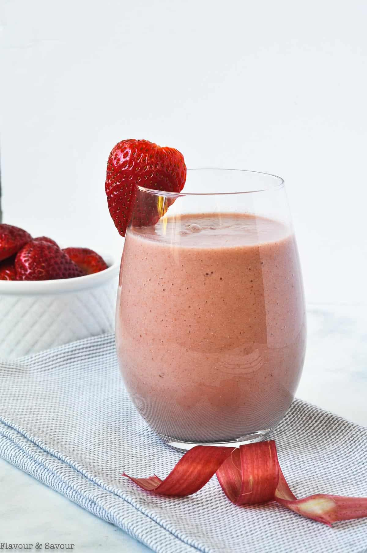 Strawberry Rhubarb Smoothie with strawberries in the background