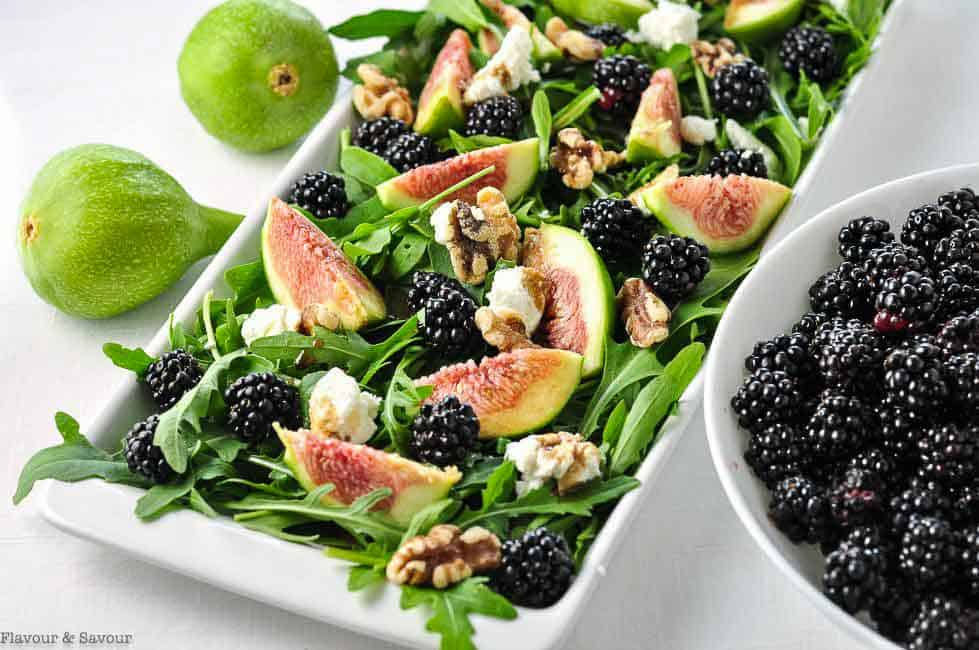 Fresh Fig Arugula Salad with Blackberries with a bowl of fresh blackberries