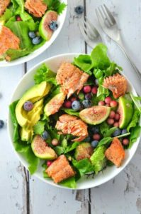 Grilled Salmon Salad with Figs and Blueberries and avocado slices in a bowl. |www.flavourandsavour.com