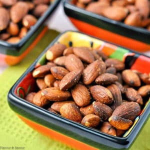 square appetizer bowls of Spanish Spiced Almonds