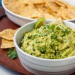Quick chunky guacamole with a bowl of tortilla chips