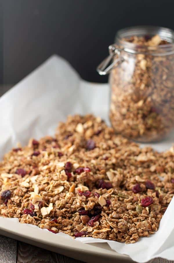 Apple Cinnamon Granola on a parchment paper-lined baking sheet