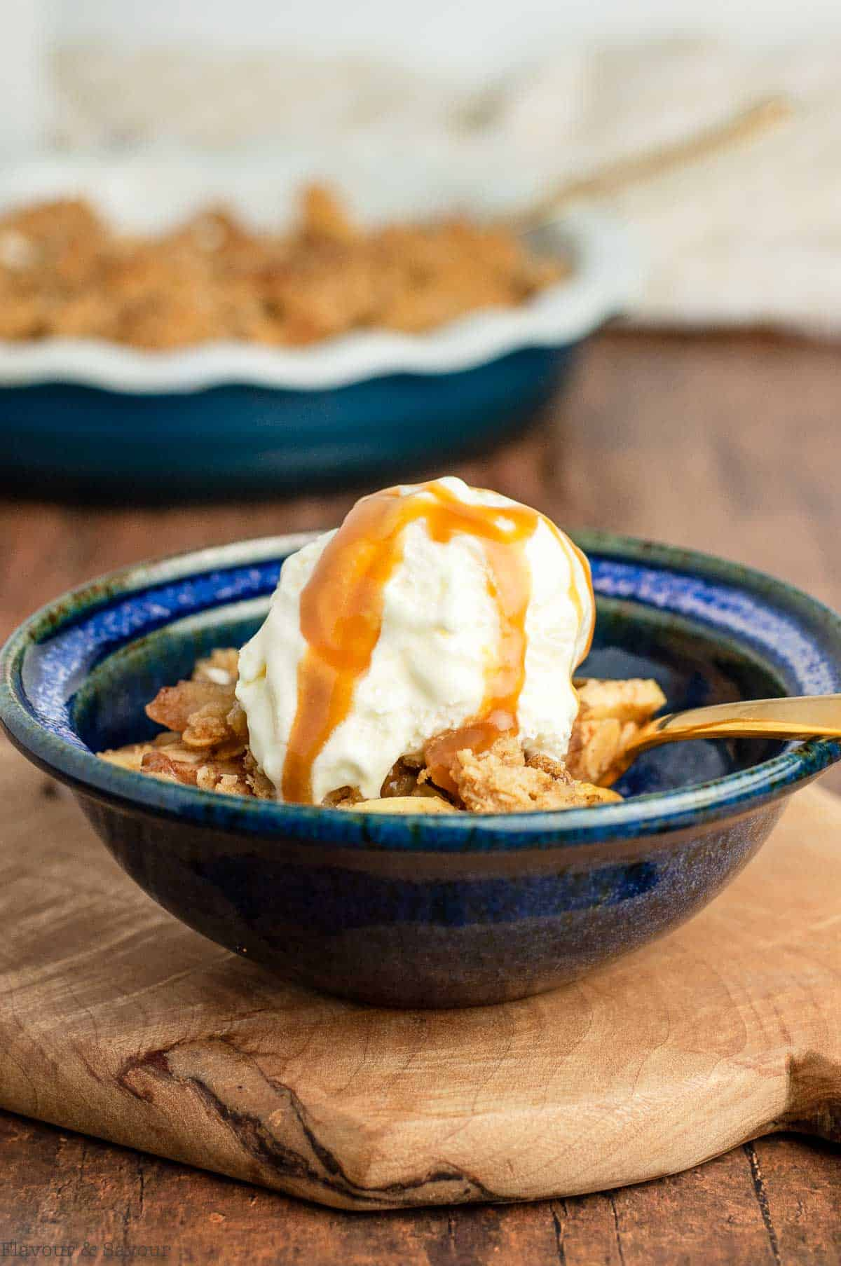 Apple crisp with ice cream and caramel sauce