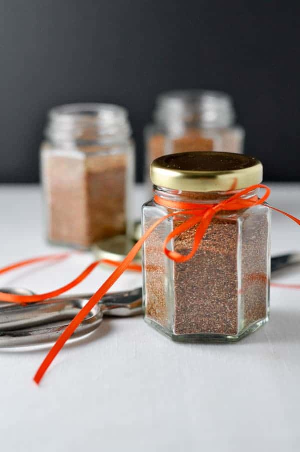 Homemade Taco Seasoning Mix in small glass jars decorated with orange ribbon.