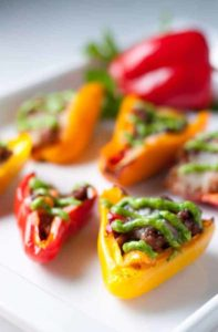 Taco Stuffed Mini Peppers. Little bites filled with taco meat and cheese and topped with avocado cream. Game-Day snack!