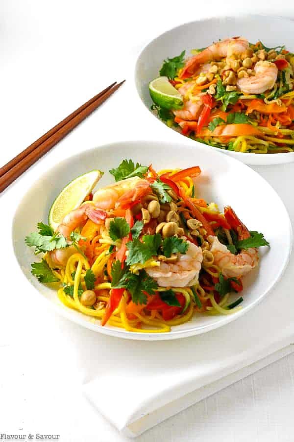 Two bowls of Zoodle Pad Thai with Shrimp with chopsticks