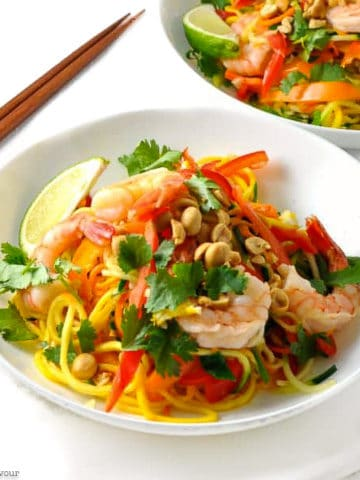 a bowl filled with Shrimp Pad Thai with fresh spiralized vegetables