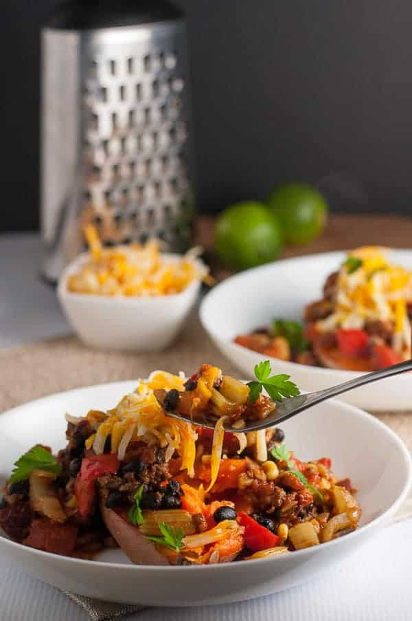 Chipotle Chili Stuffed Sweet Potatoes. A healthy weeknight meal. Fiber-rich tex-mex chili stuffed in a healthy sweet potato., topped with warm melted cheese! |www.flavourandsavour.com