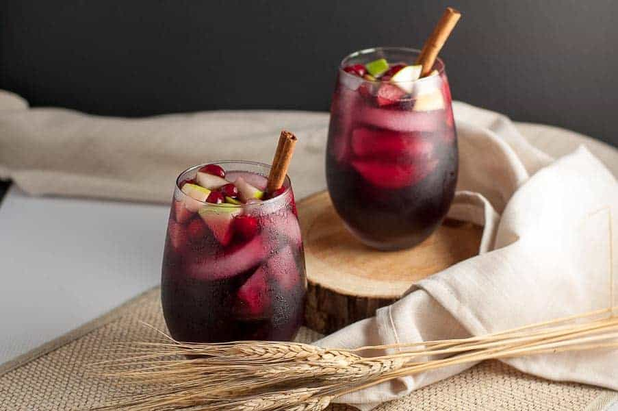 Super simple Cranberry Apple Cider Sangria. Red wine, Triple Sec, cranberry and apple juice make a crowd-pleasing drink for any season.
