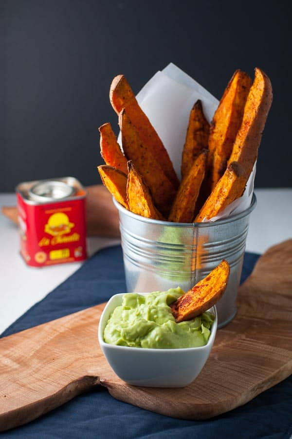 Smoky Sweet Potato Wedges in a round metal can with aioli in a small white dish.