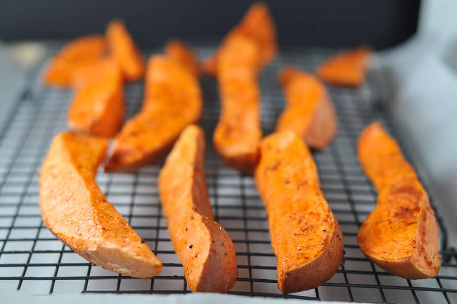 Smoky Sweet Potato Wedges that don't stick to the pan! Shown on a baking rack.