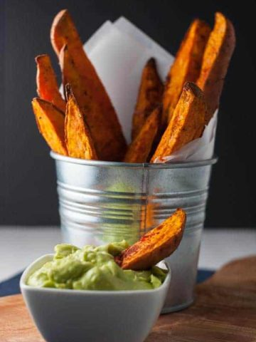 Smoky Sweet Potato Wedges that don't stick to the pan! Discover the secret to crispy fries and potato wedges and never have to scrape them off the pan again. Serve with avocado aioli. |www.flavourandsavour.com