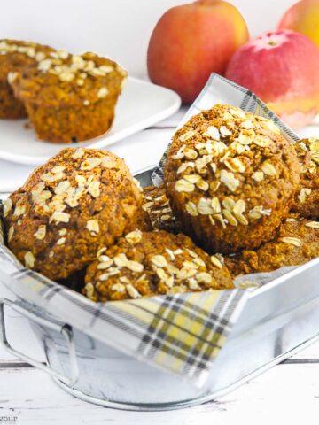 a basket of gluten-free apple muffins