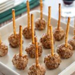 Mini Goat Cheese Balls on a Stick. Holiday party food for any time of the year. Tiny bites of goat cheese, pecorino cheese, dried cranberries and pecans, skewered with a pretzel. |www.flavourandsavour.com