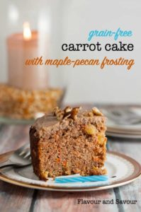 Paleo Carrot Cake on a plate with a birthday candle.