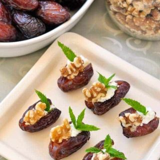 Soft and sweet Medjool Dates Stuffed with Creamy Goat Cheese, Toasted Walnuts and Fresh Mint