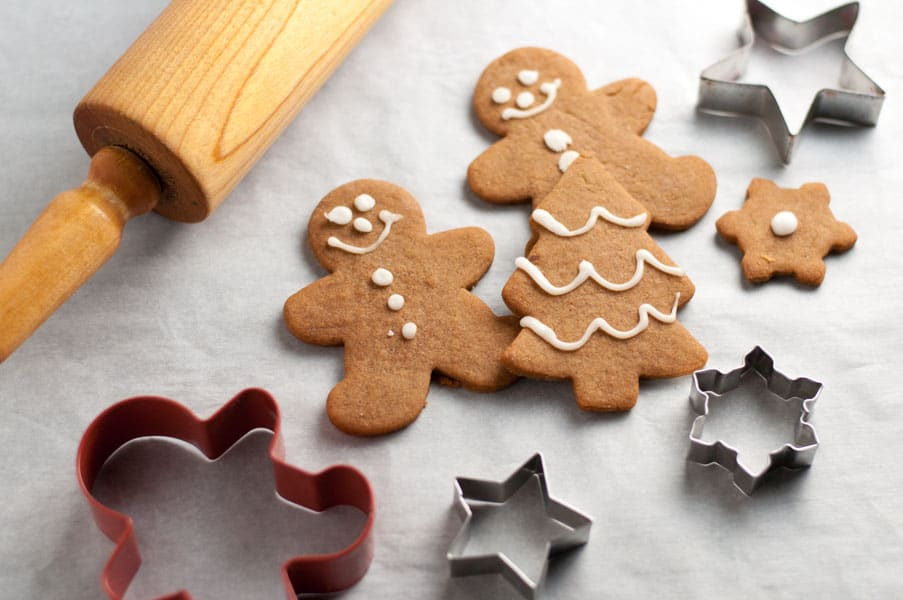 Gingerbread cookies a rolling pin and cookie cutters