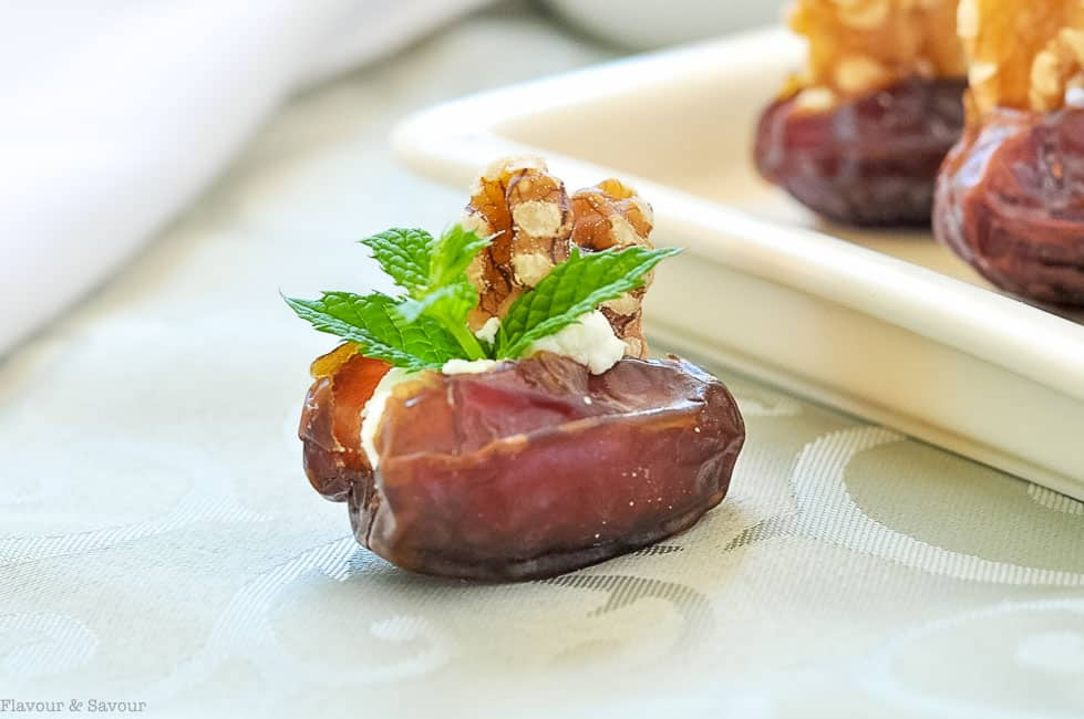 Soft and tender Medjool dates stuffed with creamy goat cheese, toasted walnuts and fresh mint makes a quick and easy appetizer.