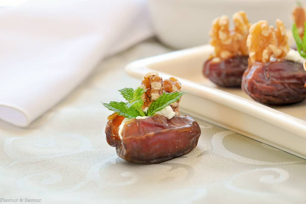 Soft and tender Medjool dates stuffed with creamy goat cheese, toasted walnuts and fresh mint makes a quick and easy appetizer. Goat Cheese Stuffed Dates are popular year round.