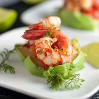 Grilled Chili Lime Shrimp with Fresh Salsa. Easy but impressive appetizer, easily assembled on sliced avocado with a dollop of fresh salsa.