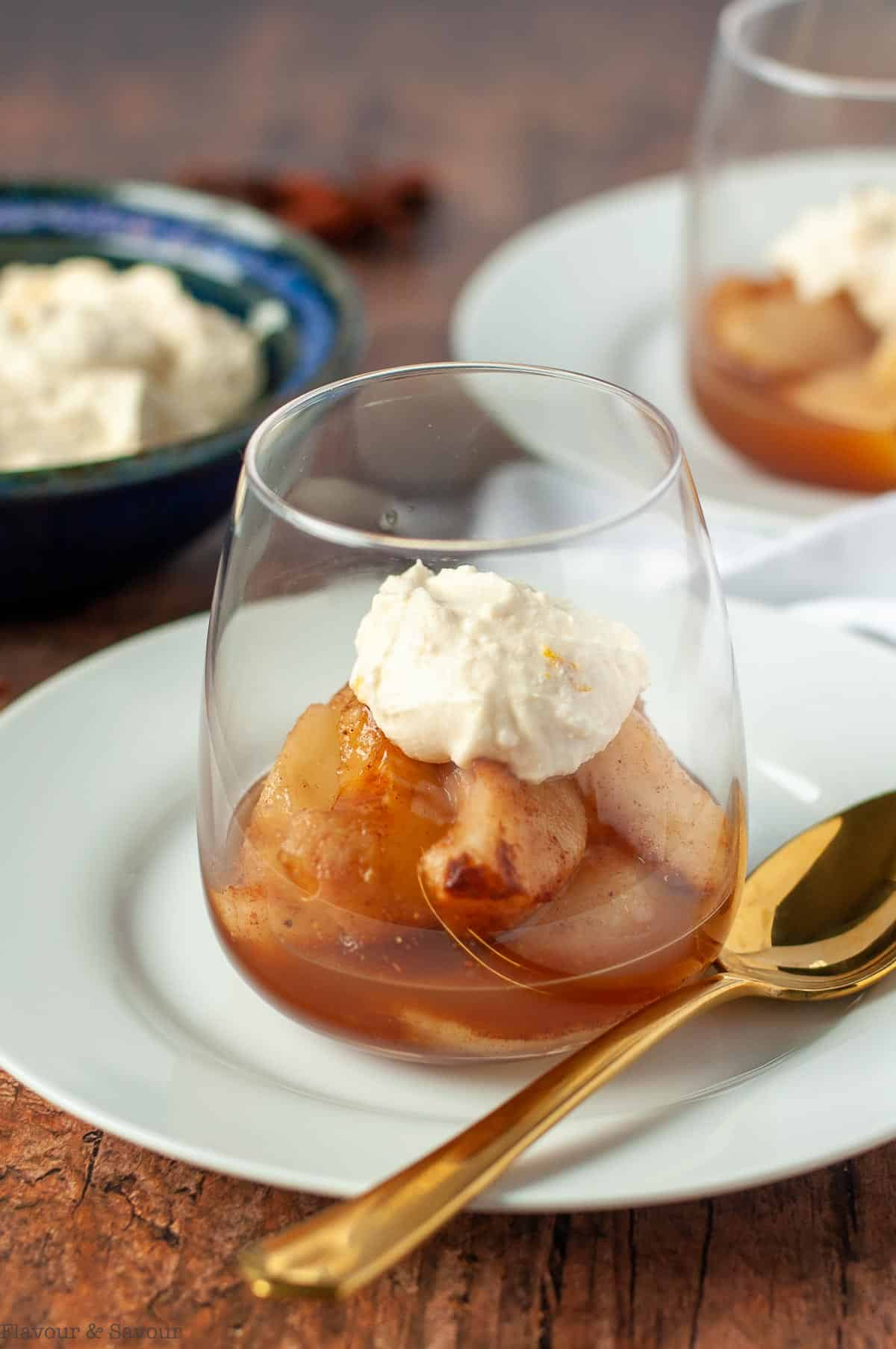 Mulled Cinnamon Orange Pears in a dessert glass with maple mascarpone cheese